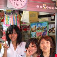 Charisma lady: Penny-candy store owner 'Auntie Hiyoko' (right) with two of her customer-friends.