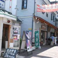 Getting around: Tourists explore an old street in central Otaru.