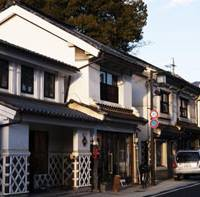 On the street: Nakamachi Street shops (left), many of which are housed in old warehouses, sell antiques, kimono and lacquerware.