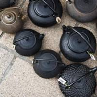 Nawate Street is home to bonsai shops, greengrocers and antique and junk shops, including one that displays traditional iron teapots on the pavement.