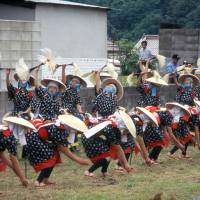 Rice-maidens, donned in bright outfits and bamboo hats, perform the rice-planting dance.   ANGELES MARIN PHOTO