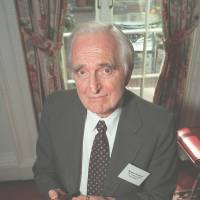 Rolling into history: Inventor Doug Engelbart poses in New York in April 1997 with the computer mouse he designed. | AP