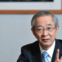 Smartphone angling: Makoto Kimura, president of Nikon Corp., is interviewed Thursday at the company's head office in Tokyo. | BLOOMBERG