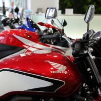 In demand: Honda Motor Co. motorcycles are displayed at the company's headquarters in Tokyo in September. | BLOOMBERG
