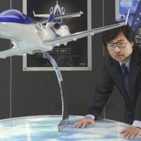 Preflight mode: Michimasa Fujino, president of Honda Aircraft Co., poses with a model of the HondaJet during an interview June 26 in Tokyo. | BLOOMBERG