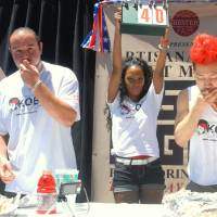 Six-time Nathan's hot dog champ holds, wins rival pigout