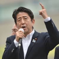 Abe accuses Chinese of 'using force'