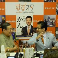 Casting for votes: Kan Suzuki (right), a Democratic Party of Japan member of the Upper House, holds a talk show with business strategist Kenichi Omae at his Net broadcast station Suzu Sta in Shinjuku in May. | COURTESY OF KAN SUZUKI OFFICE