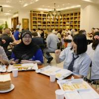 Reaching out: Muslim students share 'iftar' (evening meal) Tuesday with Japanese students at Tokyo Camii, the largest mosque in Japan, in Shibuya Ward. | KYODO