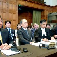 Whaling crew: The legal council of Japan, including Deputy Foreign Minister Koji Tsuruoka (left) sit in a courtroom at the International Court of Justice in The Hague on Tuesday. | KYODO