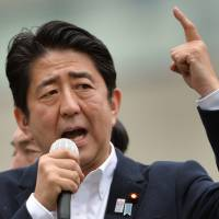 Prime Minister Shinzo Abe delivers a stump speech July 4 in Tokyo. | AFP-JIJI