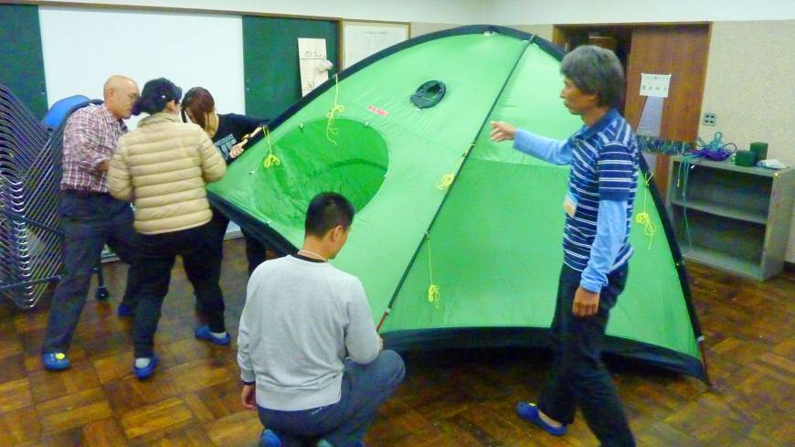 Preparedness: Hikers pitch a tent during a mountaineering class at the Nagano prefectural climbing education center May 29.