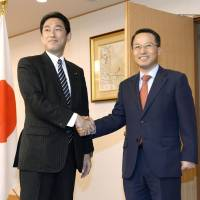 Sign of detente?: Foreign Minister Fumio Kishida (left) and Kim Kyou-hyun, South Korea's first vice minister of foreign affairs, meet in Tokyo on Thursday.   KYODO