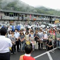 Stumping: A candidate running for Sunday's Upper House poll addresses voters at a temporary shopping mall in the Iwate Prefecture town of Otsuchi, which was devastated by the 2011 tsunami. | KYODO