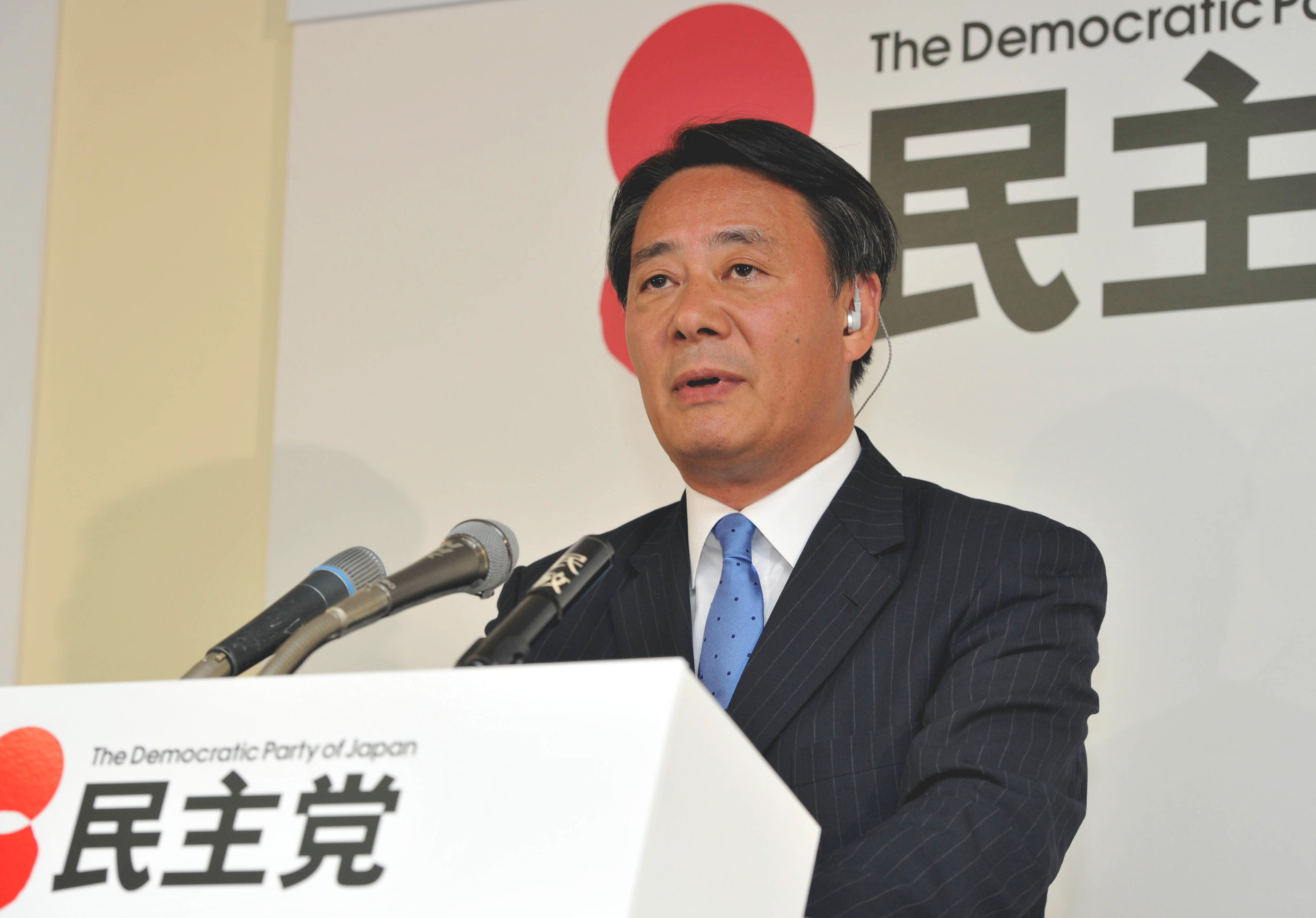 Sifting the ruins: Democratic Party of Japan President Banri Kaieda faces reporters in Tokyo on Sunday night, after the party's devastating defeat in the Upper House poll. | YOSHIAKI MIURA