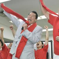 Body slam: Wrestler-turned-politician Antonio Inoki celebrates with supporters Sunday evening in Minato Ward, Tokyo, after winning a seat in the Upper House. | KYODO