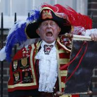 Hear ye, hear ye: Tony Appleton, a town crier,  announces the birth of the royal baby Monday, outside St. Mary's Hospital exclusive Lindo Wing in London. | AP PHOTO