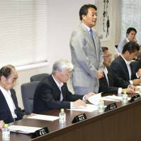 Uneasy lies the head: Democratic Party of Japan President Banri Kaieda addresses ranking members ahead of a meeting at party headquarters in Chiyoda Ward, Tokyo, on Wednesday. | KYODO