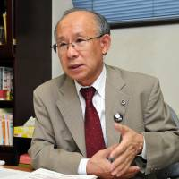 Shifting priorities: Lawyer Kenji Utsunomiya is interviewed earlier this month at his office in Chuo Ward, Tokyo. | YOSHIAKI MIURA