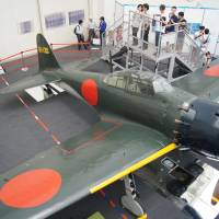 Zeke peek: A Zero Fighter Type 52, on loan from a U.S. museum, is the hottest display at Tokorozawa Aviation Museum in Tokorozawa, Saitama Prefecture. Thanks to the recent release of Hayao Miyazaki's animated film 'Kaze Tachinu' ('The Wind Rises'), visitors here tripled in June compared with the previous year, and more are expected this summer.   KYODO