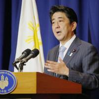 Abe tells Philippine leader of tilt toward more robust military