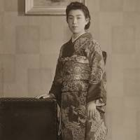 Prime of life: Hisako Miyake wearing a kimono poses for a portrait in this undated handout photograph taken in her 20s in a photo studio in Nara. | THE MATSUYAMA FAMILY/BLOOMBERG
