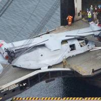 Package in transit: One of 12 MV-22 Osprey tilt-rotor aircraft that arrived at U.S. Marine Corps Air Station Iwakuni Yamaguchi Prefecture is offloaded Tuesday morning.   KYODO