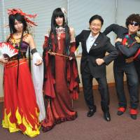 All in a day's play: Parliamentary Vice Foreign Minister Kenta Wakabayashi (third from left) poses with Chinese, Italian and Brazilian participants of World Cosplay Summit 2013 on Tuesday during their courtesy visit to the ministry. A total of 40 'cosplayers' from 20 countries are taking part in the annual event, which began Saturday in Nagoya and runs until Aug. 4. | YOSHIAKI MIURA