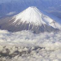 Cone of silence, for now: Mount Fuji is seen from an airplane on Dec. 8, 2010. | AP