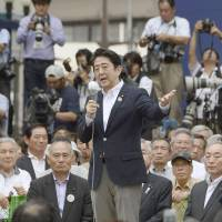 Mum on restarts: Prime Minister Shinzo Abe speaks to voters in the city of Fukushima as campaigning for July 21 Upper House election kicks off Thursday. | KYODO