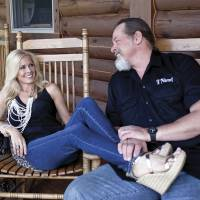 No foolin' around: Ted Nugent and his wife, Shemane, relax on their 470 hectare ranch in Concord, Michigan, on June 6. Ted, 64, said when he was younger he spent his money buying hunting property instead of drugs, like many of the musicians in his time did. Their main ranch is in Texas, but they spend time in Michigan throughout the year. | THE WASHINGTON POST