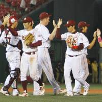Moving on up: The Tohoku Rakuten Golden Eagles celebrate their 8-4 victory over the Chiba Lotte Marines on Thursday in Sendai. | KYODO