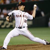 Playing with fire: Yomiuri starting pitcher Toshiya Sugiuchi delivers during the eighth inning of the Giants' 2-0 win over the BayStars on Sunday. | KYODO