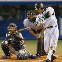Night to remember: The Tigers' Takahiro Arai strokes a third-inning RBI single in Game 2 of the NPB All-Star Series on Saturday at Jingu Stadium. Arai had three hits and was named Game MVP, helping the Central League defeat the Pacific League 3-1. | KYODO