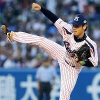 Youthful vigor: Swallows hurler Yasuhiro 'Ryan' Ogawa earns the win in Game 2 of the NPB All-Star Series on Saturday at Jingu Stadium. The 23-year-old Ogawa tossed two scoreless innings and struck out one batter. | KYODO