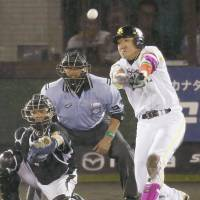 Star turn: Seiichi Uchikawa hits a tie-breaking, two-run double in the bottom of the eighth inning in the third game of the All-Star Series on Monday. | KYODO