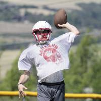 Ready for action: Ashland High School quarterback Danial White practices last Friday at Phillips Field before the Grizzlies traveled across the Pacific Ocean for the 25th anniversary of the Pacific Rim Bowl's inception. | ASHLAND DAILY TIDINGS