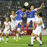 Skills to pay the bills: Marquinhos (18) scores on a 22nd-minute header in Yokohama F. Marinos' 2-1 win over Omiya Ardija on Saturday. | KYODO
