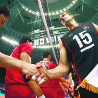 Friendly introductions: Canada captain Frederic Winters (right) takes part in pre-match handshakes before Saturday's Japan-Canada Group C mach in the FIVB World League in Osaka. | FIVB