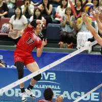 Challenging: Japan's Yu Koshikawa faces a trio of Canada defenders as he hits the ball during Saturday's match in Osaka. | FIVB