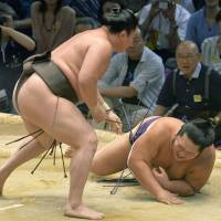 Show of force: Hakuho makes quick work of Chiyotairyu on the seventh day of the Nagoya Grand Sumo Tournament. | KYODO