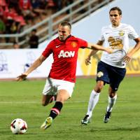 False start: Manchester United's Tom Cleverley takes a shot against the Singha All-Star XI on Saturday. | AP