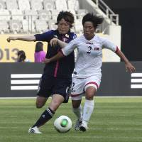 Going after it: North Korea's Choe Un Ju (right) competes for the ball against Japan's Mizuho Sakaguchi during their Women's East Asian Cup match in Hwaseong, South Korea, on Thursday.   AP