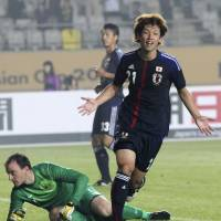 Feels good: Japan's Yuya Osako celebrates after scoring his team's second goal against Australia in the East Asian Cup match on Thursday in Hwaseong, South Korea. Japan defeated Australia 3-2. | AP