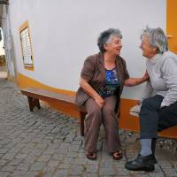 Golden girls:  Two friends catch up in  Vilas Ruivas, near the border with Spain in central Portugal.  The small village has a population of just over 40, all of whom are over the age of 50. | THE WASHINGTON POST