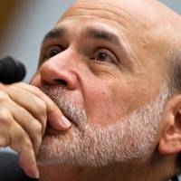 Fed approves rules requiring banks to set aside more capital