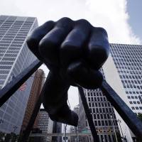 TKO: Detroit's skyline rises behind the Monument to Joe Louis, who was raised in the city and went on to become one of boxing's greatest heavyweight champions in the 1930s and 1940s. State-appointed emergency manager Kevyn Orr on Thursday asked a federal judge for permission to place Detroit into Chapter 9 bankruptcy protection. | AP