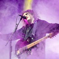 Robert Smith of The Cure belts out some of the band's biggest hits on the Green Stage on Sunday night. | JAMES HADFIELD