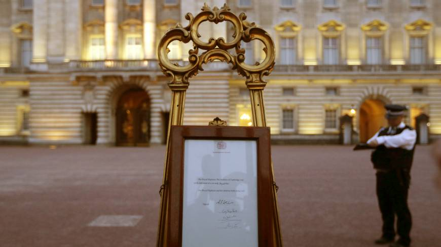 Bundle of joy: A notice proclaiming the birth of a baby boy to Prince William and Catherine, Duchess of Cambridge, is displayed for public view at Buckingham Palace in London on Monday.      AP