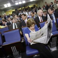 'A hero of journalism': Veteran U.S. presidential correspondent Helen Thomas takes her assigned seat, front row and center, before a ribbon-cutting ceremony for the renovated James S. Brady Press Briefing Room at the White House in July 2007. Thomas died Saturday at her Washington home at age 92.  | AP